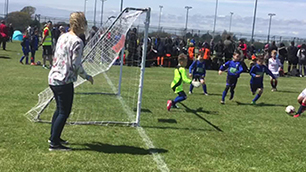 Rourke Mooney U8 smashes ball in the top corn