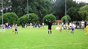 8 year old hits a Beckham like free kick in f